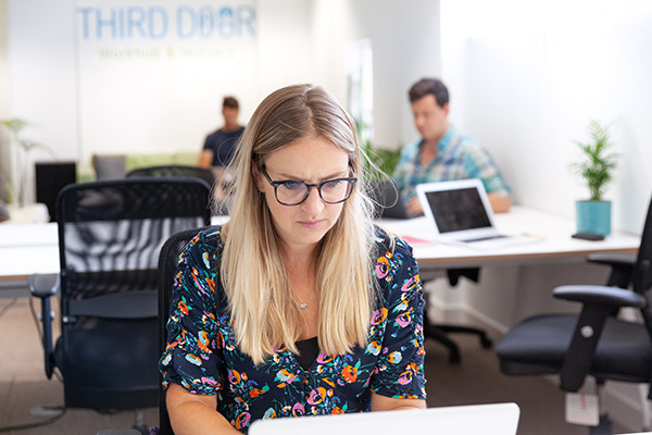 A woman working at Third Door