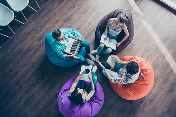 a group of freelancers collaborating on a project in a co-working space