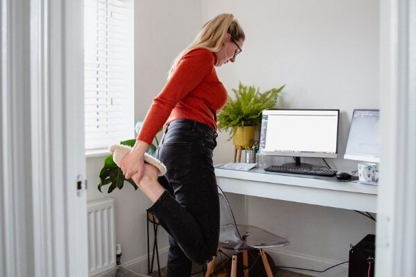 Freelancer stretching at home
