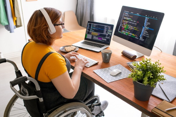 Woman in a wheelchair working at a desk